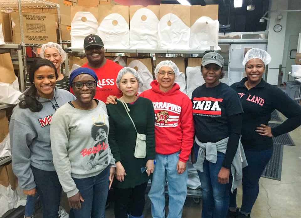 Group of alumni volunteering at food bank